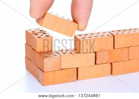 put in the last brick in a wall