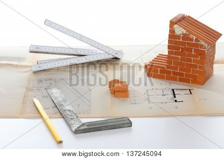 construction symbol with tools house and plan