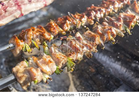 Pork skewers on the grill outdoor in restaurant
