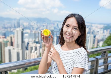 Woman showing the famous local food