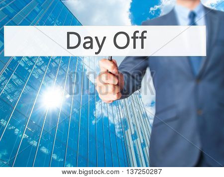 Day Off - Businessman Hand Holding Sign