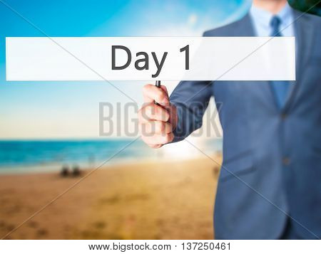 Day 1 - Businessman Hand Holding Sign