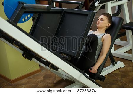 girl practicing on the simulator at the gym