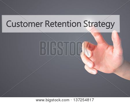 Customer Retention Strategy - Hand Pressing A Button On Blurred Background Concept On Visual Screen.