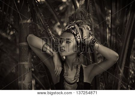Attractive Young Boho Woman In Turban With Jungle Background