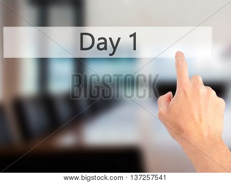 Day 1 - Hand Pressing A Button On Blurred Background Concept On Visual Screen.