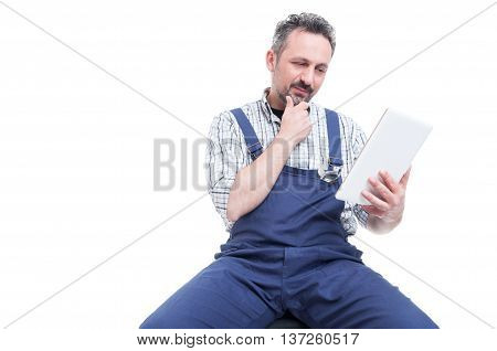 Handsome Mechanic Reading Something On Digital Tablet