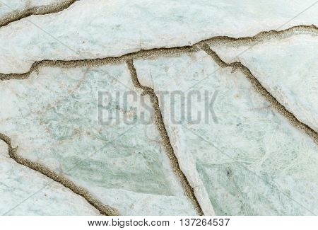 Closeup surface abstract marble pattern at the cracked marble stone floor texture background