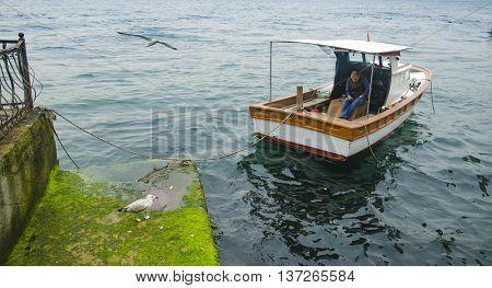 Istanbul Turkey - March 28 2015: Istanbul Bosphorus views And Uskudar Kuzguncuk coast a man resting on the boat.