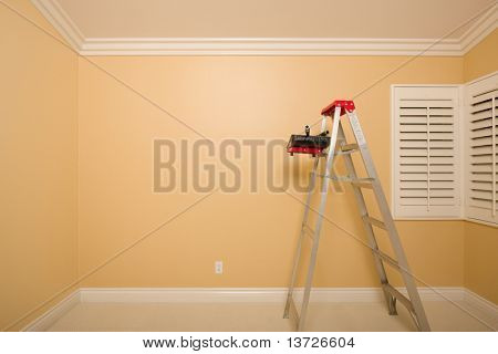 Empty Room with Plantation Shutters, Ladder, Paint Tray and Rollers.