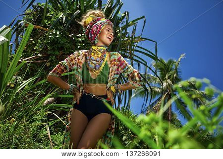 Attractive Boho Woman Outdoors At Jungle Background