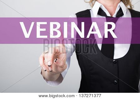 webinar written in search bar on virtual screen. technology, internet and networking concept. Internet technologies in business and home. woman in business suit and tie, presses a finger on a virtual screen.