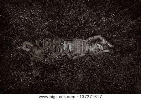 fashion boho beautiful woman in turban lying on the grass