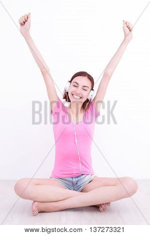 young womn sit listen music and smile caucasian