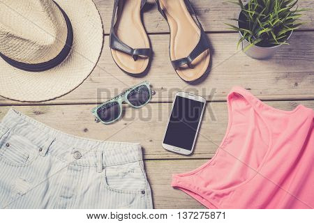 Online shopping concept with smart phone and clothes