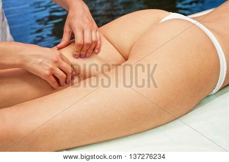 Legs and buttocks woman massage to reduce cellulite