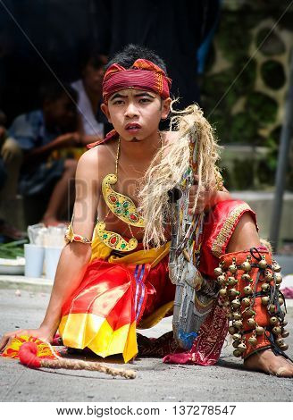 Traditional Dancer In Colorful Costume Is Performing Dance For T
