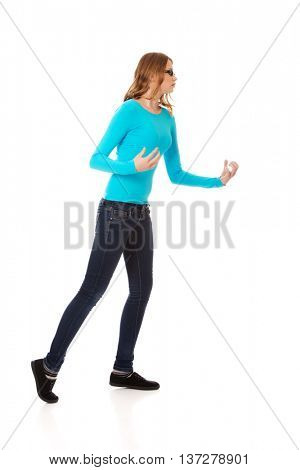Angry teenage woman making fists