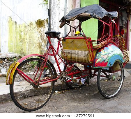 JOGJAKARTA INDONESIA- JAN 16: Becak are waiting for clients in the street on jan 16 2011 in Jogjakarta
