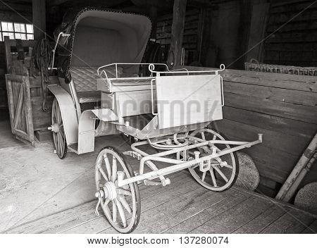 Vintage Coach Stands In Rural Garage
