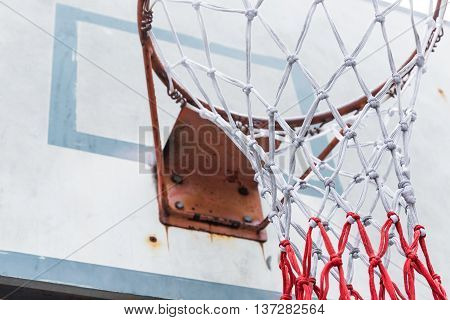 Close up basketball hoop net with drity old board