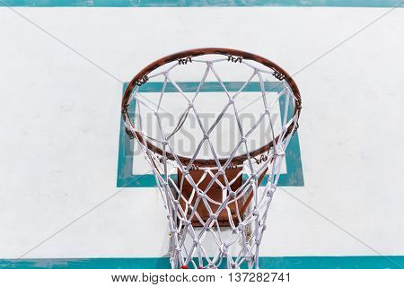 Close up red basketball hoop with white board