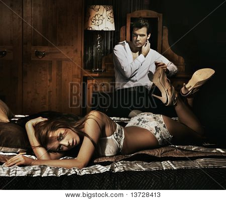 Sexy couple in bedroom
