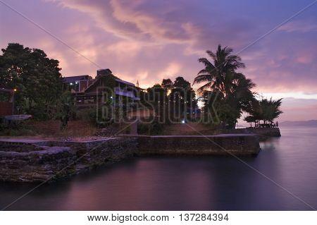 Sunset on peninsula Tuk-tuk. Island Samosir Lake Toba. Sumatra