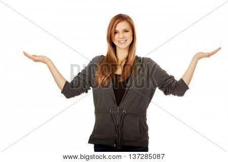 Teenage woman presenting something on both palms