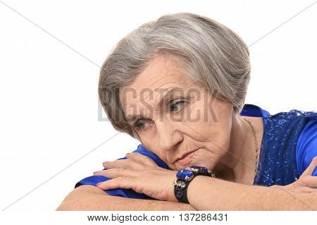 Portrait of a sad an elderly woman on colored background