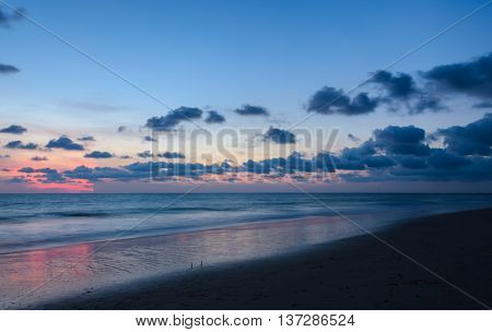 Tropical beach sunset with beautiful twilight skyline afterglow