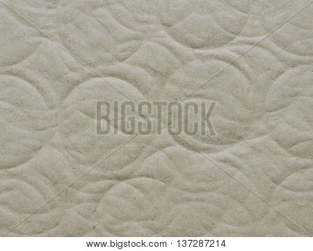 Recycled corrugated cardboard paper texture background with debossed circle shape