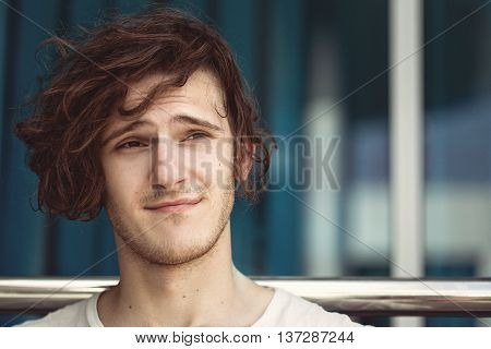 handsome sexy guy with long dark hair