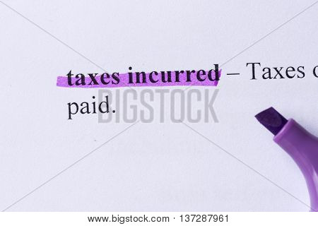 Taxes Incurred Word Highlighted