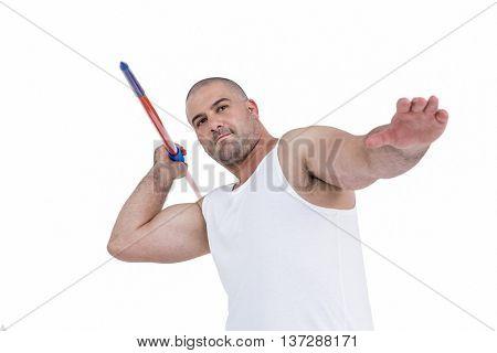Athlete preparing to throw javelin on white background