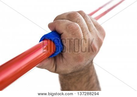 Close-up of hand holding javelin on white background