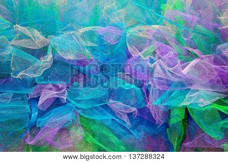 Background from multi-colored pieces of fabric. Decoration