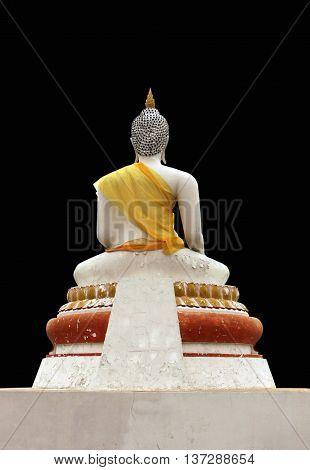 old buddha statue on black backgroundback of buddha statue