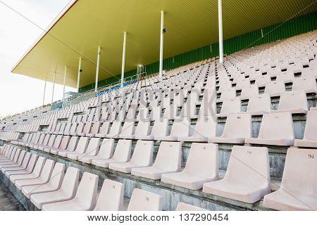 Empty row of white seats in stadium