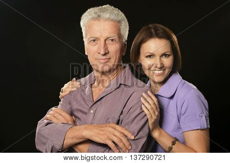 Happy senior father and daughter giving a tenderness hug