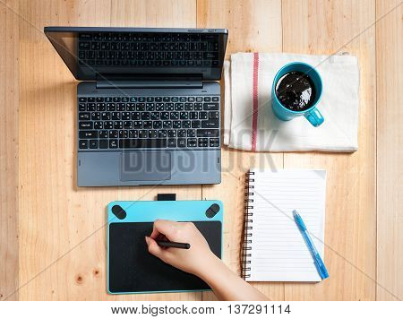 Hand Of Woman Creative Professional Designer's Desk From Above