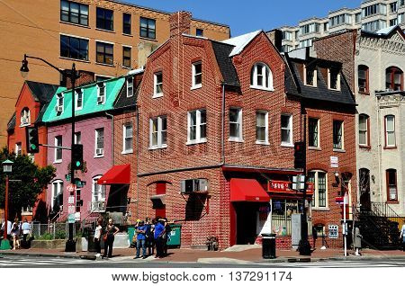 Washington DC - April 12 2014: Handsome 19th century brick buildings at H and 6th Streets NW in Chinatown