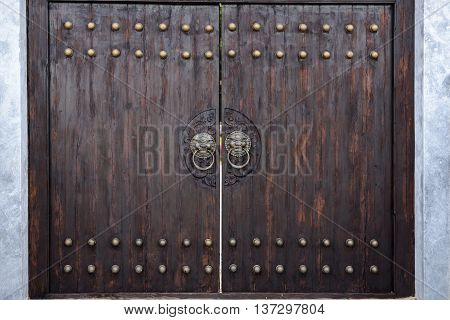 massive wooden gate in the Japanese style.