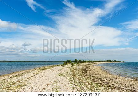 Point of the Saare rocky coastline against scenic cloudscape Kassari island Estonia