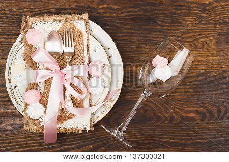 Tableware With Light Pink And White Meringues