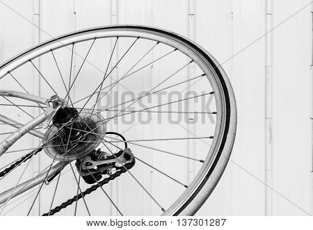 Part of old bicycle wheel derailleur and chain (black and white effect)