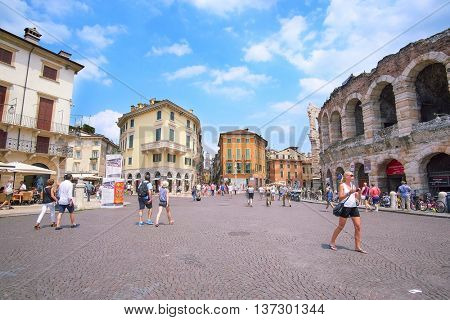 VERONA, ITALY - JULY, 2, 2016: people in the area infront of Arena of Verona (in Italian it is called Arena di Verona) -ancient amphitheatre used today as a stage for concerts and Opera performances
