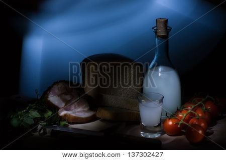 Still life of food and liquor made in the house of the Russian countryside.