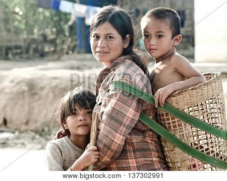 KON TUM, VIET NAM, JULY 22, 2016 6 babies strapped on their backs mother, Ede, Kon Tum, Central Highlands,