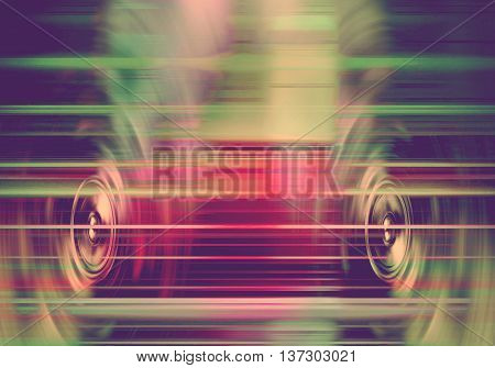 Retro audio speakers with blurred light streaks